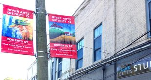 Wayfinding banners help support River Arts District vitality during RADTIP construction